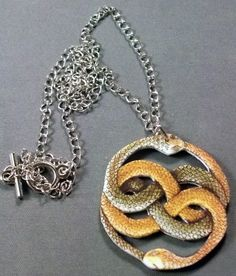 Auryn from The Neverending Story Necklace by ShopNightOwlDesigns, $15.00