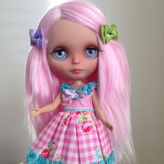 Custom Blythe doll with re-rooted pink hair.