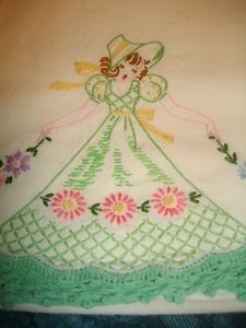 Vintage southern belle pillowcase...my gradma and aunt made me a set of these in pink.  I still have them.