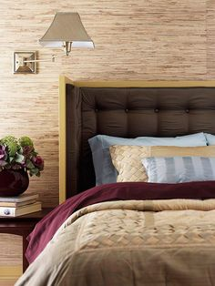 A soft blue and a deep wine color make pretty complements to this rich brown bedroom. See more upholstered headboards: http://www.bhg.com/rooms/bedroom/headboard/stylish-upholstered-headboards/?socsrc=bhgpin022713brownbedroom=18