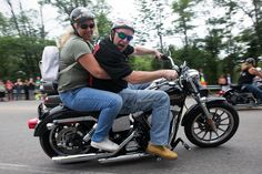 People drive their bikes during the 10th annual charity motorcycle ride to benefit Joanna's Place, named for the little girl who was murdered by her cousin, at the Elks Club on Saturday July 15, 2017, in Weymouth. Photo by Lauren Owens Lambert / for The Patriot Ledger.