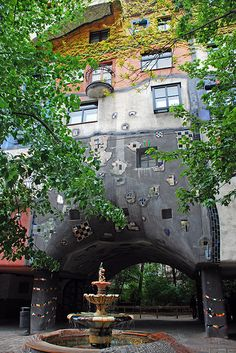 Hundertwasserhaus, Vienna . Have a pic of Evan at this fountain