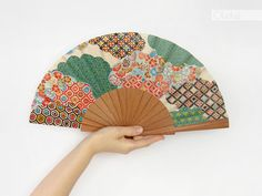 This wooden hand fan features a beautiful geometric japanese print in green, red and mustard. A perfect gift for Mothers Day.  Hand-crafted by me with