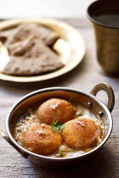 malai kofta recipe - one of the most requested recipes – malai kofta. a dish which is popular as well as most sought after vegetarian indian dish in restaurants.  malai means cream and kofta are fried dumpling balls. usually they are made up of mashed potatoes-veggies, with or without grated paneer. in this recipe the koftas are made with potatoes and paneer. these melt in the mouth koftas are dunked in a creamy, sweet and mildly spiced curry.