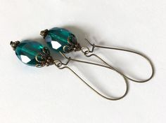 Antique Green Earrings Vintage Style Long Dangle Earrings Faceted Emerald Green with Antiqued Brass Emerald Earrings, Green Earrings, Dangle Earrings, Emerald Green, Blue Green, Bead Caps, Vintage Fashion, Vintage Style, Vintage Earrings
