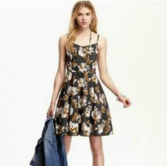 Floral Printed Cami Dress Lightweight an super comfy. Dark gray with floral magnolia print. Spaghetti strapped camisole top flows out to a swing skirt. Adjustable straps, back zipper with elastic side panels for better fit. Easy to wear, easy to care in 100% rayon. Old Navy Dresses