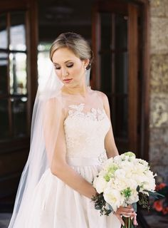 Lace illusion neckline wedding dress: http://www.stylemepretty.com/2015/11/06/rustic-elegance-at-camp-yonahnoka/ | Photography: Clark Brewer - http://www.clarkbrewerphotography.com/