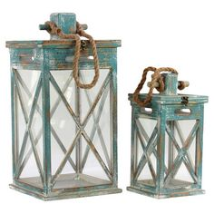 Love these weathered wooden candle lanterns!
