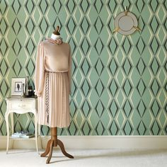 Deco Diamond represents the glittering 1930s, taking inspiration from the emerald onyx ornaments, enamel kitchenware, and Wayne Hemingway's own collection of 78 record covers from the 1930s. Deco Diamond vintage wallpaper brings a contemporary flare to the alarmingly true color palette of the 1930s.