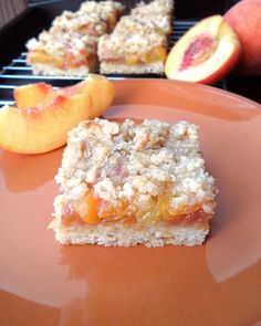 Healthier Whole Wheat Peach Crumb Bars - sweet peaches on a oat crust with crunchy oat crumble topping. Made healthier with whole wheat flour, coconut oil and Greek yogurt!