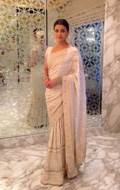 Beautiful white sari worn by Aishwarya Rai from the House of Kotwari collection. Love the fine pearl work on the sari and beautifully accessorized by her. Bollywood Saree, Bollywood Fashion, Saree Fashion, Indian Look, Indian Ethnic Wear, Indian Dresses, Indian Outfits, Saris Indios, Costumes