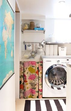 Pretty laundry room...love the skirted sink with the bright Manuel Canovas floral and the striped rug
