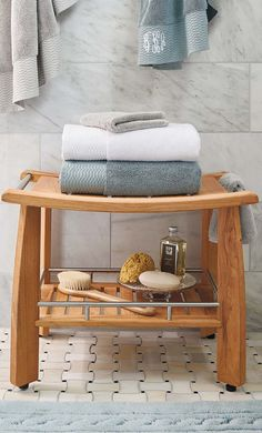 Designed by Frontgate, our Resort Teak Shower Bench with Shelf combines solid teak and stainless steel to elegantly weather damp, humid climates. This teak bathroom bench will rival any you've seen in five-star spa hotels.