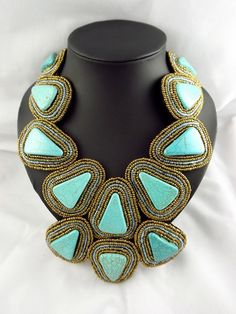 Ravishing Triangular Turquoise Semi Precious Bib Necklace Adorned with Gold Beads.