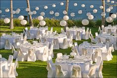 VERY pretty....   A lot of white with your colors as accent here and there....    Table cloths, depending on tables, are almost required, chair covers, not so much, but if get white chairs...