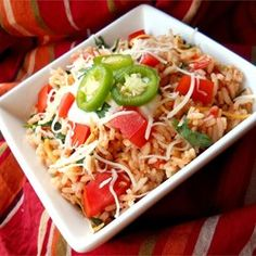 "Mexican Rice III - This is an excellent authentic Mexican rice recipe (not to be confused with Spanish rice) that I make as a side dish with all of my Mexican dishes. The key is cooking the rice properly and using good quality chicken broth or stock.""  - Allrecipes.com"