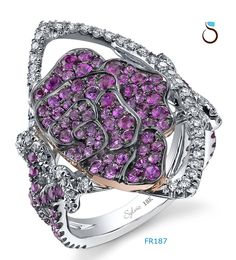 Don't let your left hand have all the fun! Pink Sapphire + Diamond fashion ring set in 18K White Gold + Rose Gold & surrounded by Black Rodium.