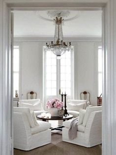 Parisian glamour in an all-white palette with a pop of pink.