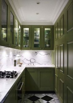 The Best in Dark Green Kitchen Trends - Town & Country Living Olive Green Kitchen Cabinets with Checkerboard Floor Two Tone Kitchen Cabinets, Green Cabinets, Kitchen Cabinet Colors, Painting Kitchen Cabinets, Kitchen Paint, New Kitchen, White Cabinets, Colored Cabinets, Kitchen Small