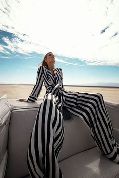 Julia Stegner by Solve Sundsbo (wide-angle lens perspective #fashion photo of woman wearing #striped pajamas in yacht on sand) #yachtphotoshoot