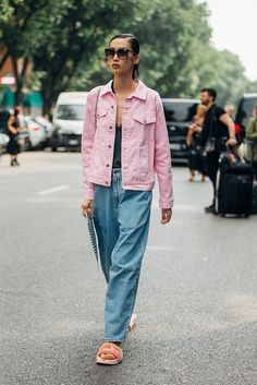 Baggy boyfriend jeans, a baby pink denim jacket and Fenty X Puma fluffy pink sliders: could this Milan Fashion Week street style look be any more perf?