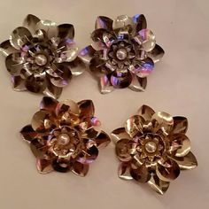 Gold and silver Flower earrings. These r 2 sets of earrings, one gold and one sliver both With a pearl stud in the middle. Not heavy on the ears. ?? very cute on. Jewelry Earrings