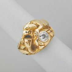 GUSTAV MANZ GOLD AND DIAMOND FIGURAL RING : Lot 2002