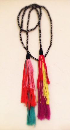 Image of b&w rope necklace with multi colored tassels