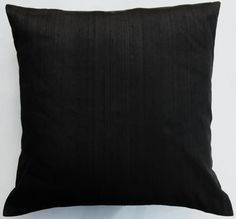 black throw pillows and window seat