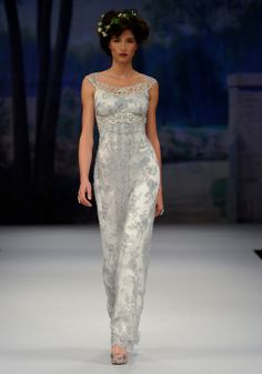LUMIERE    Spring 2012  Slate blue beaded lace sheath with sheer back and silver guipure embellishments lined in pearl silk
