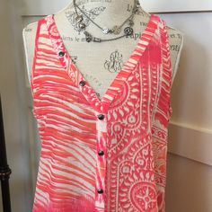 Double V-Neck tunic top Cute V-neck in front & back! Orange, pink and white colors. Has silver buttons up both the front and back! Cute! Longer in the back than the front. 100% polyester- machine wash low/tumble dry low. Cute for summer! Worn twice- like new. Maurices Tops Tunics