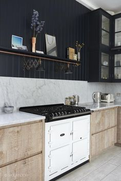 Kitchen | marble backsplash | marble countertop | light wood contemporary base cabinets | black upper cabinets |industrial style - london home 4