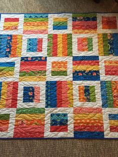 This beautiful quilt has all the colors of the rainbow except violet. It began with a Moda jelly roll called Fancy and a pattern called Radio