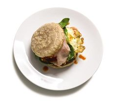 Egg Sandwich With Ham and Spinach recipe: The slightly runny egg yolks will mingle with the bread, ham, and spinach and create an instant sauce as you eat this sandwich.