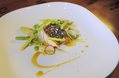 """Shown here is a pan-seared rockfish with spring vegetables and artichoke puree. The operators of the new Chesapeake describe their menu as """"sophisticated regional cuisine."""" """"It's not a seafood restaurant,"""" said Marco Daigle, one of the partners in the new restaurant."""