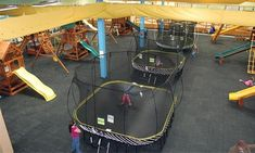 Playground-equipment show room allows little ones to unleash their energies on slides and swings and in playhouses