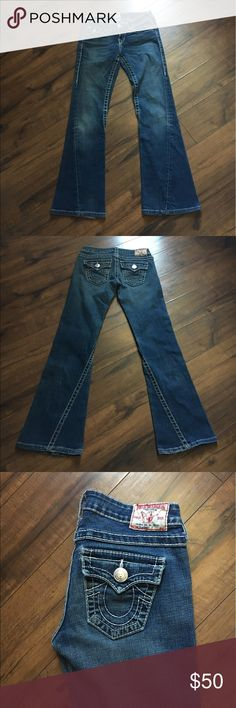 """True Religion Bootcut jeans, small flare Standard blue True Religion bootcut jeans.  Light wear only on the bottoms (see pic), great condition!  Size 26, actual waist: 31"""", inseam: 30"""", flare width: 9"""".                                         Check out more jeans in my closet                                  To Post Office same/ next day  True Religion Jeans Boot Cut"""