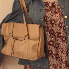 Beige Leather Handbag Very soft leather shoulder bag. Some marks to interior lining. Purchased in a local boutique. Smoke free home. Please message me if you have questions. ginger michelle Bags