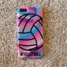 I'm selling a phone case It is a pink purple and blue phone case that has a volleyball on it and has little spikes that are soft. It has been used for a week but in great condition without tags. It is for an IPhone 5C Claire's Accessories Phone Cases