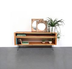 This design is in stock and can be prepared for dispatch within 3-5 days from order. This solid wood cabinet is designed to be used as a console storage unit, a TV Stand and media table, or a low sideboard. The lower component has an opening of 22cm high (9), ideal for books and DVDs,