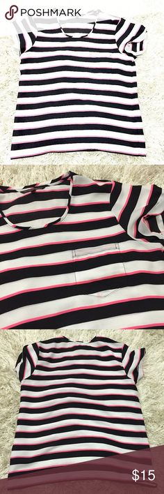 Victoria's Secret Striped Chiffon Tee VS black, white and pink striped chiffon tee. Worn only a few times. Small light pink mark on bottom of front pocket, I'm not sure if it leaked from the pink on the top, but it is barely noticeable. Front pocket on top. Loose flowy fit. Size small. 100% polyester. Victoria's Secret Tops Blouses