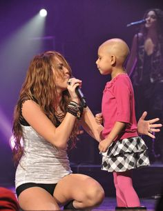 Even if you are MILEY Hater-- everyone should see this, THAT little girl right there? she had cancer and died 2 weeks later, but Miley made that little girls dream come true. to sing on stage with her idol. Miley Ray Cyrus.