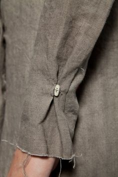 Gathered sleeve with a single button holding it in place...could do this with pants too.