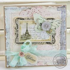 Gorgeous handmade card.  I love the multiple hand stitched layers of papers and the doily. Beautiful ribbon and bow...love the color and blends well with the other soft colors used. ♥ Love ♥