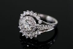 """The two sides that """"embrace"""" the centre Halo symbolise this lady and Lee coming together to form one family. Wedding Mood Board, Engraved Rings, Halo Rings, Designer Engagement Rings, Halo Diamond, Ring Designs, Hug, Heart Ring, Centre"""