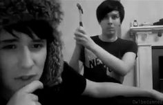 Dan doesn't even look fazed by the fact that he could get hit with a hammer but Phil still feels bad about it xD