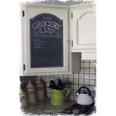 Chalkboard on a corner kitchen cabinet