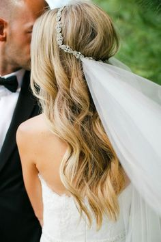 bridal hair down in curls with diamond veil halo