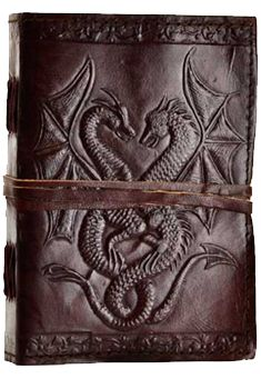 "Double Dragon leather journal, hand made. Includes 240 pages with a cord closure. 5"" x 7"""