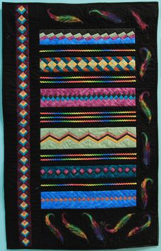"""Wall Quilt 17, """"Falling Feathers"""" by Kerry Cohen  """"This quilt presents my twist on Seminole-style patchwork. The feather fabric inspired my color choices for this piece. The lecture and workshop by Kay Smith on Seminole-inspired patchwork detailed the sewing method for the pieced patchwork strips. The rick rack references design elements from authentic Seminole clothing."""" Rick Rack, Capital City, Inspire Me, Design Elements, Feathers, Choices, Projects To Try, Workshop, Quilting"""